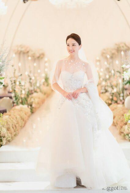 Mira bride wearing Audrey gown