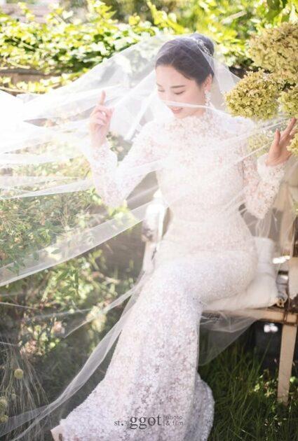 Mira bride wearing Alena gown