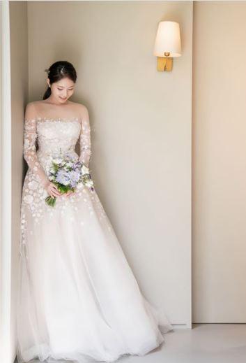 Mira bride wearing Maike gown