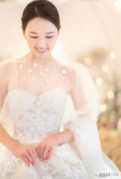 Mira bride wearing Audrey gown and matching cape