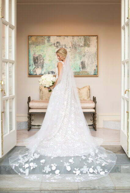 Mira bride wearing Julie gown and matching Veil