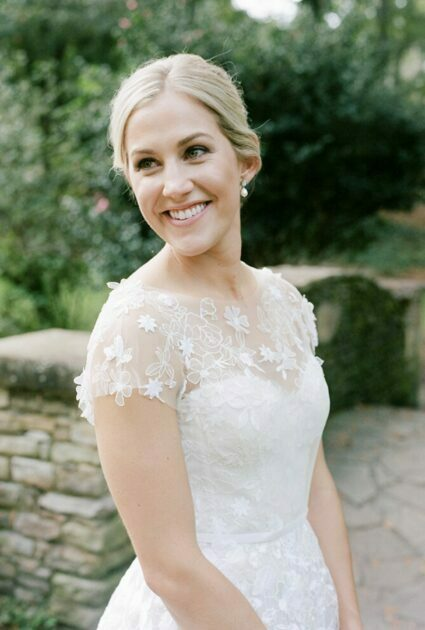 Meredith wearing Andi gown with matching topper