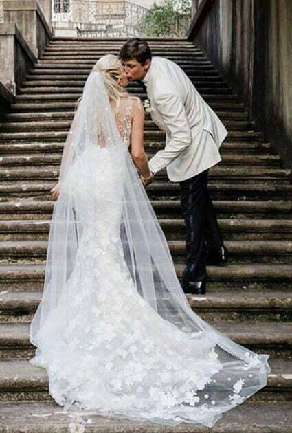 Mira bride wearing Verona gown and veil