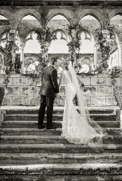 Mira bride wearing Veronica gown with matching veil