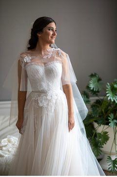 Elisa Cohen wearing Amy gown
